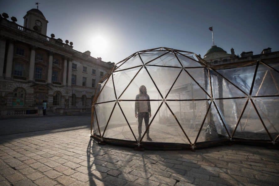 Visitor experiencing Pollution Pods by Michael Pinsky