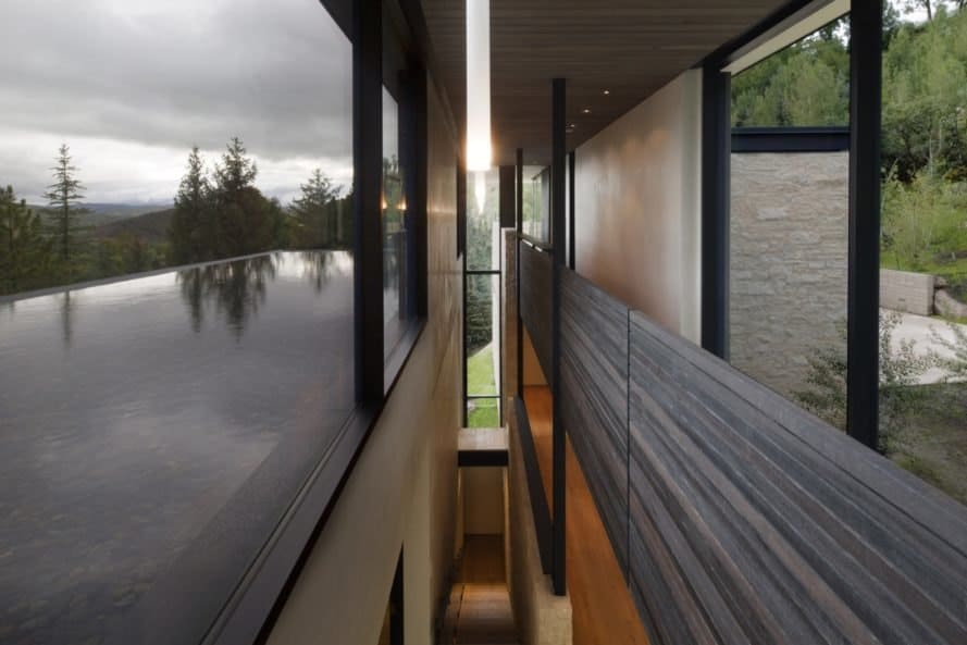 glazed view of the outdoors and reflecting pool