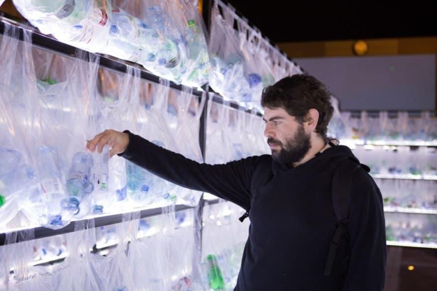man looking at wall