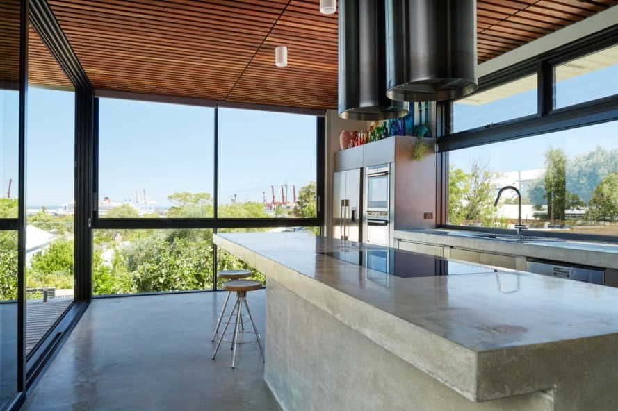 Kitchen with marble island and floor to ceiling windows