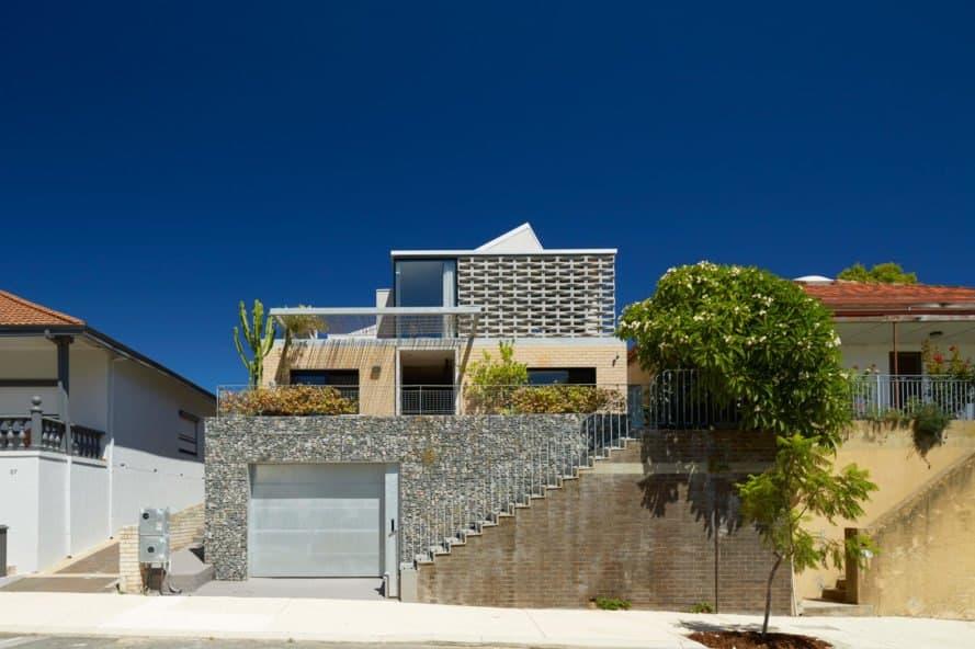 modern tan brick home with garage