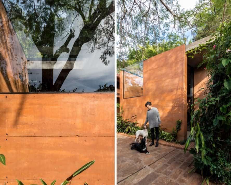rammed earth building and woman with dogs