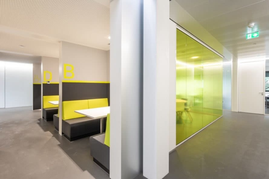 room with green glass wall and green seating